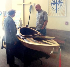 Urban Promise's Jeff VanderKuip with a Kayak built by Urban Promise students.