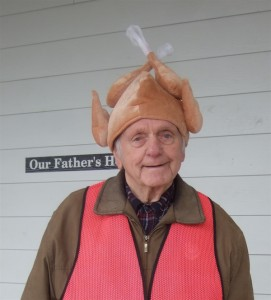 """Yogi, the Our Father's House """"Crossing Guard"""" in his famous thanksgiving Turkey Hat."""